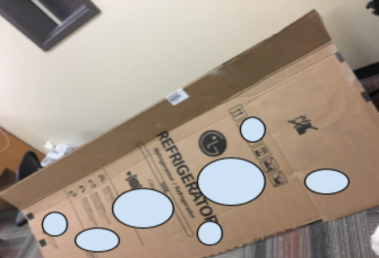 Holes outlined on the box