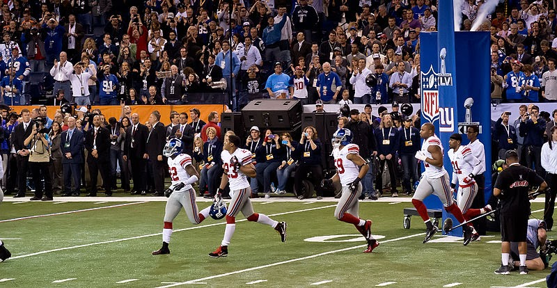 The New York Giants running out of the tunnel at Super Bowl XLVI.