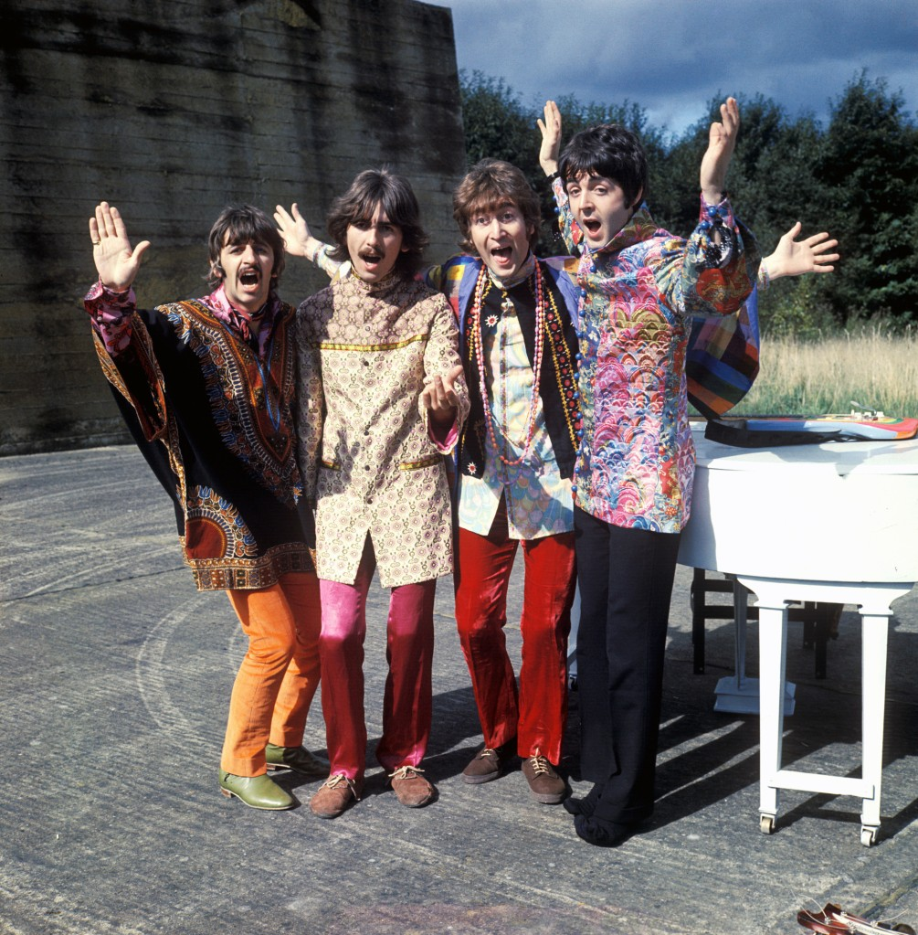 "The Beatles during the filming of the ""I Am The Walrus"" music video in 1967."